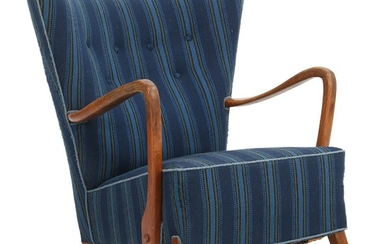 Fritz Hansen, attributed: An easy chair with legs and armrests of patinated oak. Seat and back upholstered with blue wool.