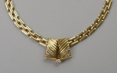 Necklace in 18 karat yellow gold and its pendant in 18 karat yellow gold set with brilliant-cut diamonds for a total of +/- 0.40 carats. L.:+/-42cm. Dim.pendant: +/-2.6x2.4cm. Total weight: +/- 54 gr.