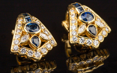A pair of ear clips made of 750 gold with sapphires and brilliant cut diamonds
