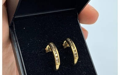Pair of 9ct yellow gold earrings with 0.3ct diamonds inset, ...