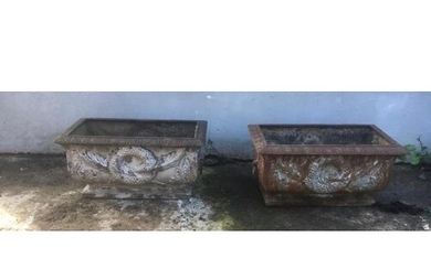 Pair of cast iron garden planters decorated with swags and w...