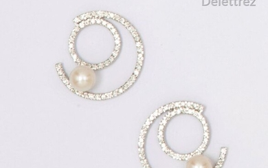 """Pair of white gold """"Concentric"""" earrings, entirely set with brilliant-cut diamonds and finished with a cultured pearl. Stem clasp. Diameter: 2.4cm. Rough weight: 8.1g."""