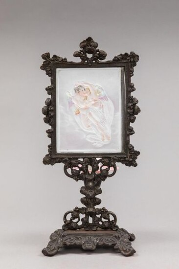 Porcelain lithophany enhanced with colors representing the love taking away Psyche. In a cast iron frame with a patina of rocaille shape. On the back a ring holds a glass bowl that can hold a candle.