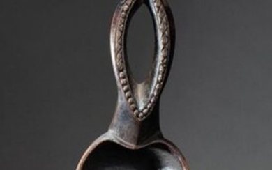 Ritual spoon, the handle carved with an openwork pattern evoking a female sex
