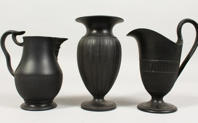 TWO WEDGWOOD BLACK BASALT MILK JUGS and A VASE, 5ins