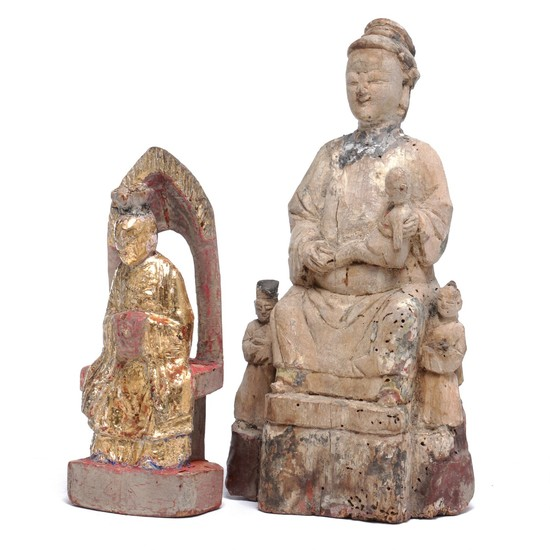 Two figures of wood, one partially gilded, in the shape of Daoist God and woman with child. H. 20 and 28 cm. (2)
