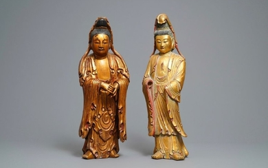 Two large Chinese gilt lacquered wood figures of...