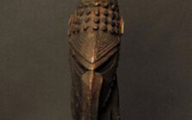 Wooden standing figure with dark patina