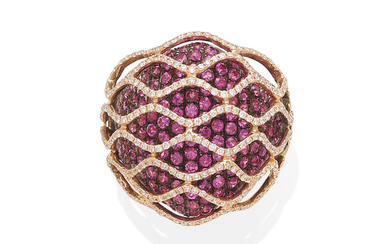 an 18k gold and pink sapphire ring