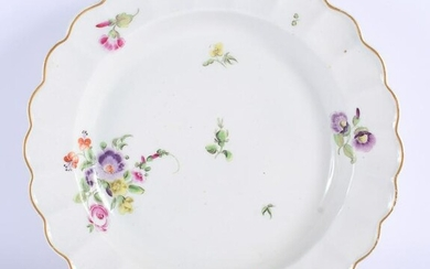 18th c. Worcester plate painted with coloured flowers.