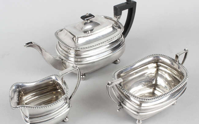 A 1920's silver three piece tea service by James Dixon & Sons.