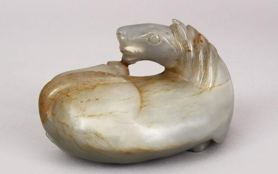 A CHINESE 19TH / 20TH CENTURY CARVED JADE FIGURE OF A