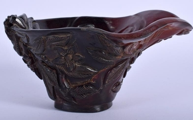 A CHINESE CARVED BUFFALO HORN TYPE LIBATION CUP. 15 cm