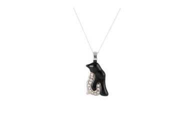 A DIAMOND AND ONYX PENDANT, modelled as a penguin, mounted i...
