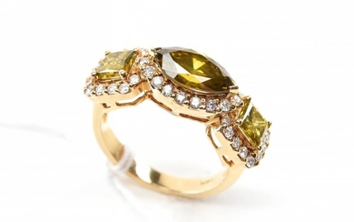 A MARQUISE AND PRINCESS CUT TREATED DIAMOND RING