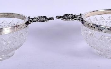 A PAIR OF LATE VICTORIAN SILVER MOUNTED GLASS BOWLS.
