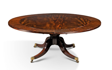 A REGENCY MAHOGANY CIRCULAR EXTENDING DINING-TABLE