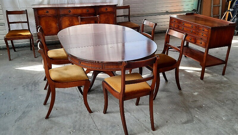 NOT SOLD. A Regency style mahogany dining room suite consisting of a dining table, six...