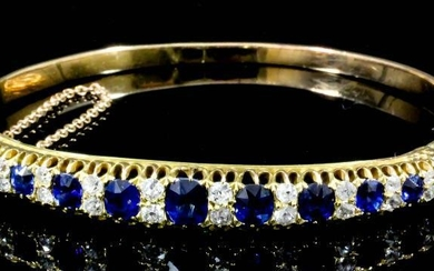 A Sapphire and Diamond Stiff Bangle, Modern, in gold...