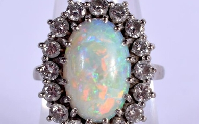 A VINTAGE 18CT WHITE GOLD OPAL AND DIAMOND RING. 8.2