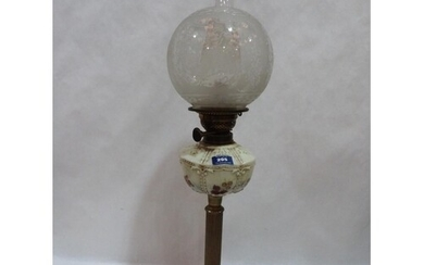 A Victorian oil lamp with etched shade and opaque glass foun...