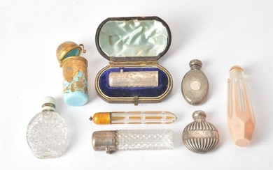 A collection of eight various scent bottles
