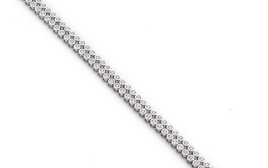 A diamond bracelet set with numerous brilliant-cut diamonds weighing a total of app. 4.88 ct., mounted in 18k white gold. H/VVS-VS. Triple excellent-cut.