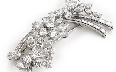A diamond brooch in the shape of a flower branch set with numerous brilliant and baguette-cut diamonds weighing a total of app. 12.41 ct., mounted in platinum.