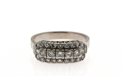 A diamond ring set with numerous brilliant-cut diamonds, mounted in 14k white gold. Size app. 54.5.