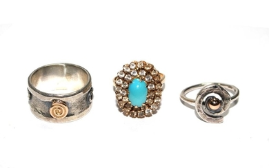 A gold and turquoise ring and two silver rings (3)