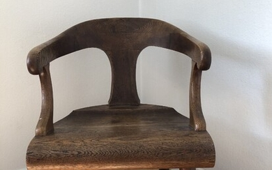 A late 19th century English elm chair with swivel legs. H. 77. W. 55 cm.