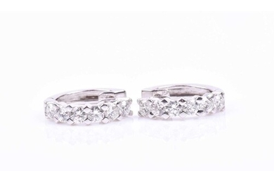A pair of 18ct white gold half hoop earrings, inset with six...