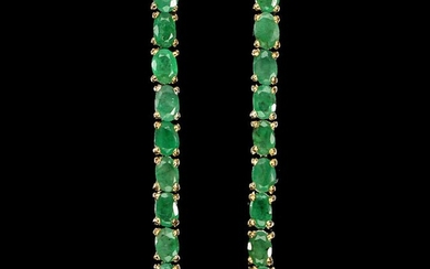 A pair of emerald ear pendants each set with numerous oval-cut emeralds, mounted in rhodium and gold plated sterling silver. L. 5,2 cm. (2)