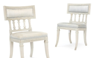 A pair of painted late Gustavian side chairs. Sweden, ca. 1810. (2).