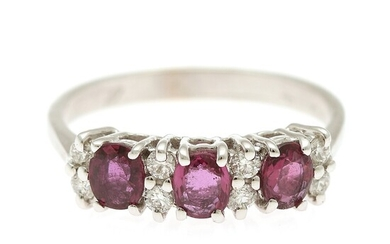 A ruby and diamond ring set with three rubies weighing a total of app. 1.24 ct. and eight brilliant-cut diamonds, mounted in 18k white gold. Size 54.
