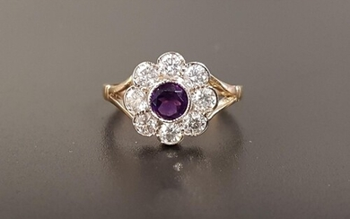 AMETHYST AND DIAMOND CLUSTER RING the central round cut amet...