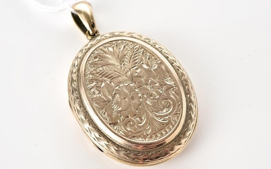 AN ANTIQUE GOLD LINED ENGRAVED LOCKET, 50mm x 31mm