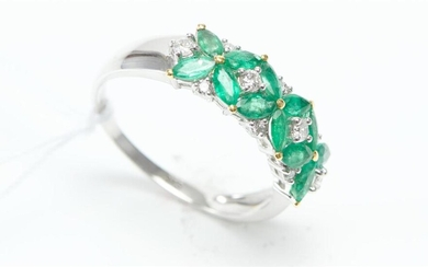 AN EMERALD AND DIAMOND DRESS RING IN 9CT WHITE GOLD, FEATURING NAVETTE CUT EMERALDS TOTALLING 1CT, WITH DIAMOND DETAILS TOTALLING 0....