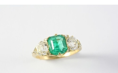 AN EMERALD AND DIAMOND THREE STONE RING the octagonal-shaped...
