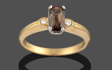 An 18 Carat Gold Andalusite and Diamond Three Stone Ring,...