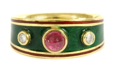 An 18ct gold enamel ruby and diamond ring, a round cabochon ruby with a brilliant cut diamond at each side, all rub set to plain collets, to the slightly tapered head with green guilloché enamel and red enamel border. A court section shank with feature...