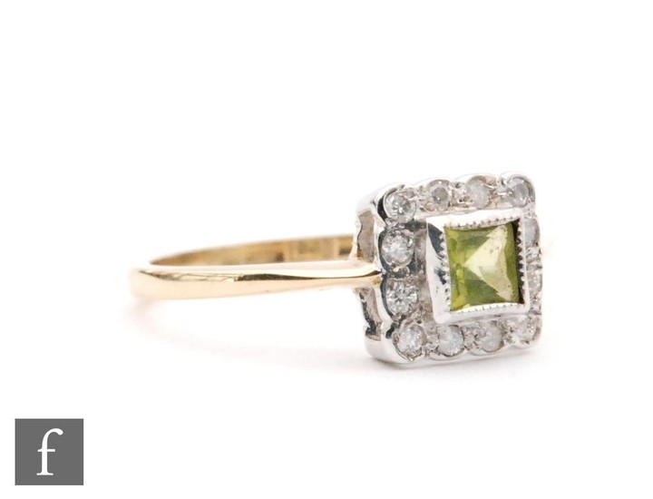 An 18ct peridot and diamond cluster ring, central square per...
