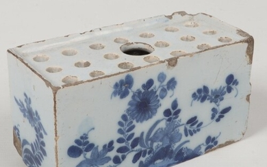 An 18th century Delft flower brick. Painted in blue with flo...