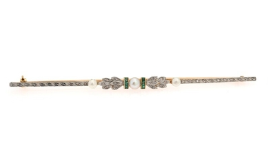 SOLD. An emerald and pearl brooch set with three cultured freshwater pearls, emeralds and diamonds,...
