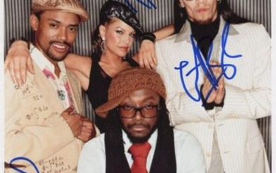 BLACK EYED PEAS THE: Signed colour 7 x 10.5 photograph by all four members of the American musical group The Black Eyed Peas individually, comprising Will.i.am, Apl.de.ap, Taboo and Fergie, the image depicting Will.i.am seated in a half length pose...