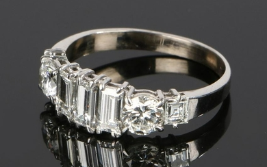 Diamond set ring, with baguette and round cut diamonds