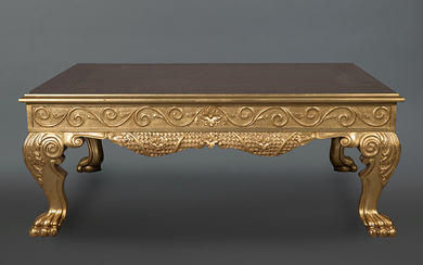 Empire style coffee table in carved and gilded wood with relief decoration of vegetable elements. On claw feet. Size: 48x102x122cm. Exit: 10000uros. (166.386 Ptas.)