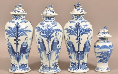 Four Blue and White Oriental Porcelain Covered Vases.