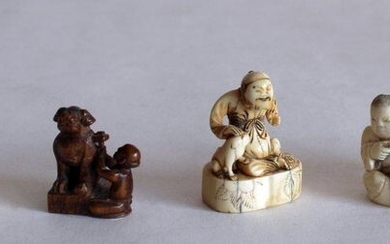 JAPAN, late 19th century. Lot of five NETSUKES and GROUPS, four in ivory, woman smoking pipe and sawyer, dog figure, child playing drum (missing) and child with a Fô dog mask, and one in carved wood carving figure of a sitting Fô dog.5x 6 x 3 cm, H. 4...