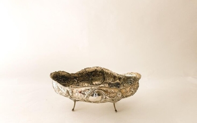 Large four-legged planter in the Rocaille style, 19th century, chased silver, traces of stamps, w. 52,5 cm [wear and tear and slight alterations].